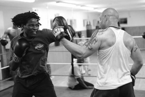 Boxing Training in Ring Black and White Image