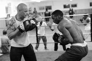Men Sparring in Ring Black and White Image